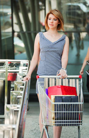 Woman with shopping cart Stock Photo - 11721554