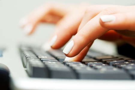 computer hardware: Female hands typing on computer keyboard