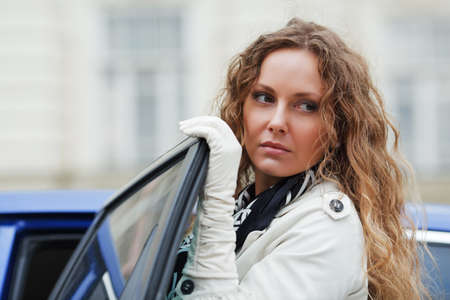 Woman with a car photo