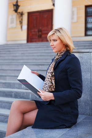 Young businesswoman with a notebook photo