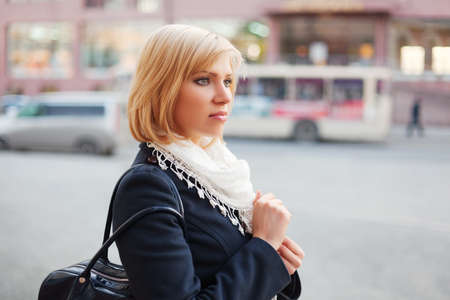 Young woman on the city street photo