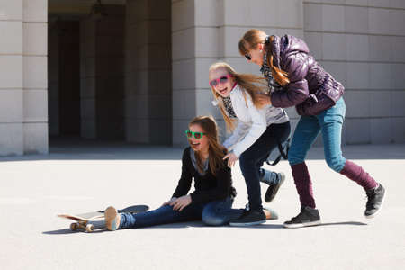 Teenage girls with skateboard photo
