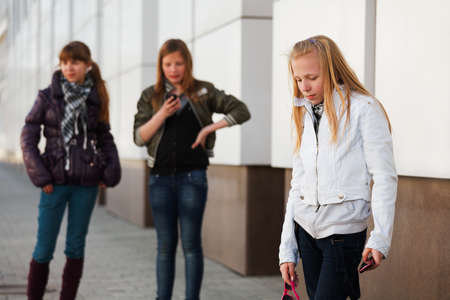 Teenage girl with a mobile phone photo