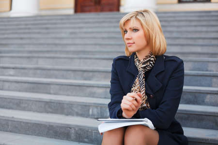 Young businesswoman with a notebook Stock Photo - 12025498