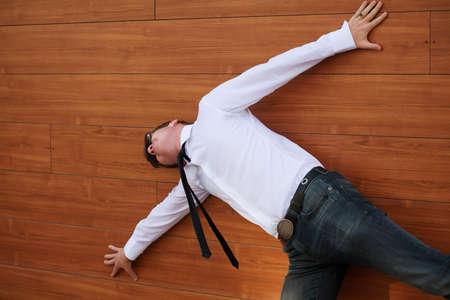 lying down on floor: Yuong man in despair lying on the floor Stock Photo
