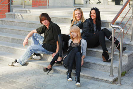 Young people relaxing on the steps photo