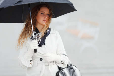 Woman with umbrella Stock Photo - 12398921