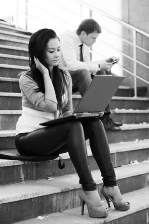 Young woman using laptop photo