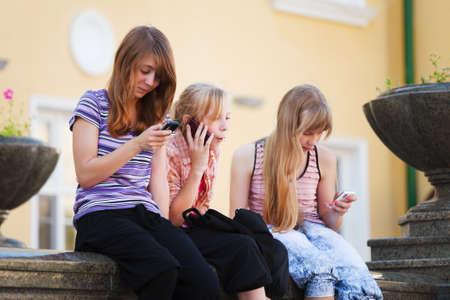 Teenage girls calling on the mobile phones photo