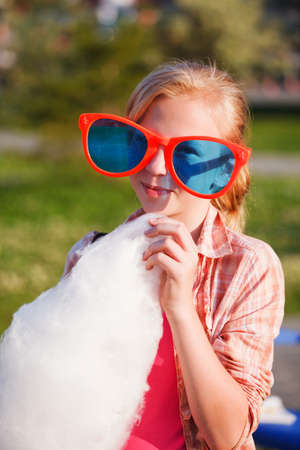 cotton candy: Girl eating cotton candy