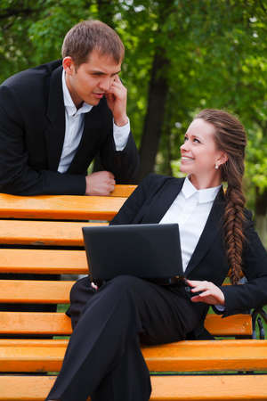 Young business people with laptop Stock Photo - 12634041