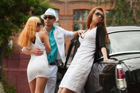 jealous: Young couple and jealous girl Stock Photo
