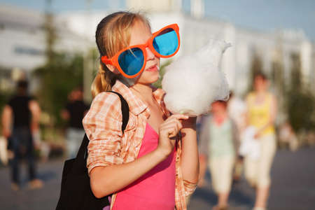 life styles: Girl eating cotton candy