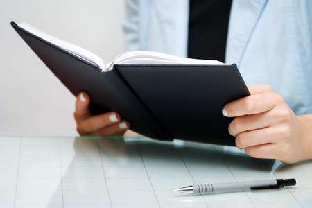 Businesswoman reading Stock Photo