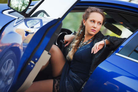 Woman in a sports car photo