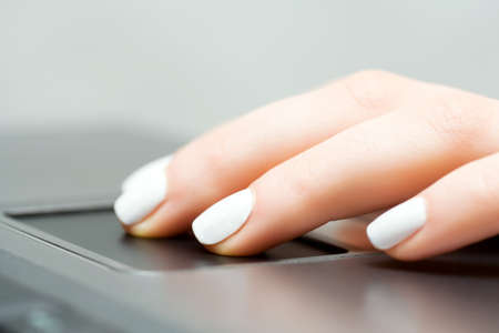 touchpad: Female hand using touchpad Stock Photo