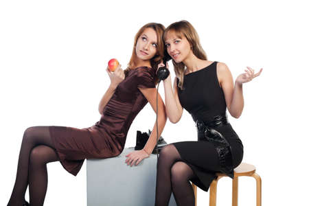 sexy office girl: Two young women with a retro phone