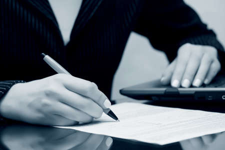 Businesswoman signing contract  写真素材
