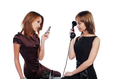 Two young women with a retro and modern phones photo