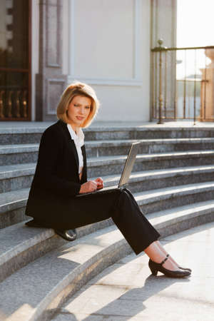 Young businesswoman using laptop  photo