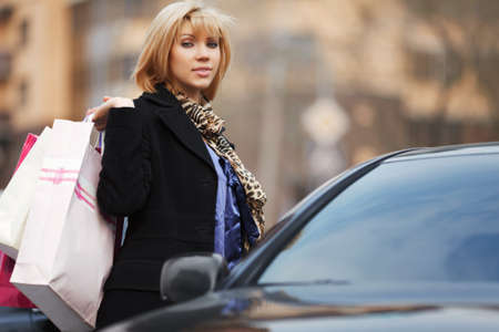 Young shopper with a car Stock Photo - 13321983