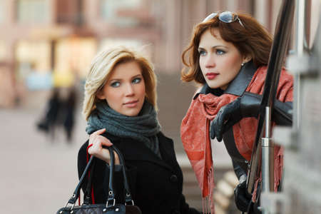 Young women on a city street  photo