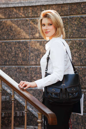 Young businesswoman on the steps photo