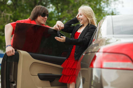 Young couple with a new car photo