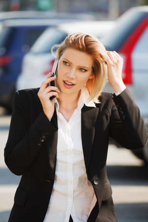 Young businesswoman calling on the phone  photo