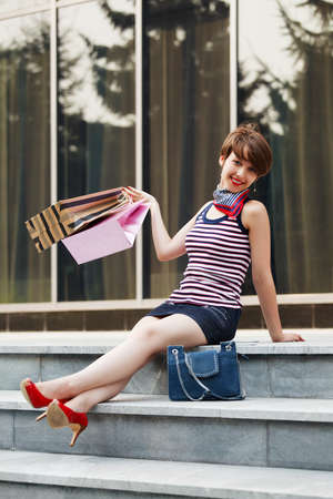 Happy shopper on the steps photo