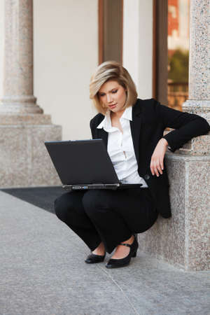 Young businesswoman working on laptop photo