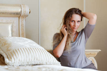 Beautiful woman in a bedroom Stock Photo - 14741900