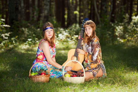 Hippie girls with a fruit basket photo