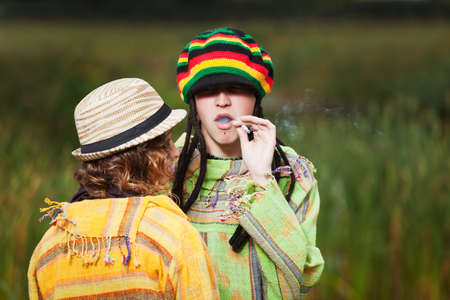 Young rastafarian people in autumn park photo