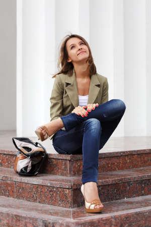 handbag model: Happy young woman on the steps