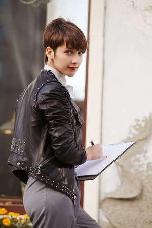 Young businesswoman holding a clipboard Stock Photo - 15972147