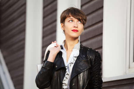 Young woman in leather jacket photo