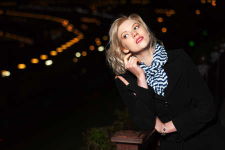 Young woman against a night city lights Stock Photo - 15972191