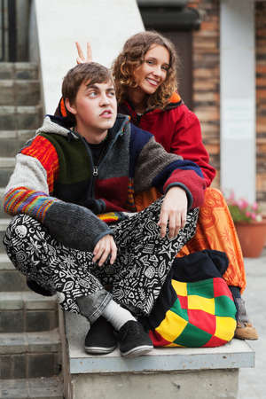 rasta hat: Young hippie couple on the steps Stock Photo