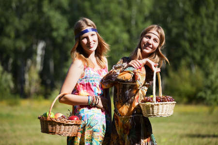 Young girls with a fruit basket photo