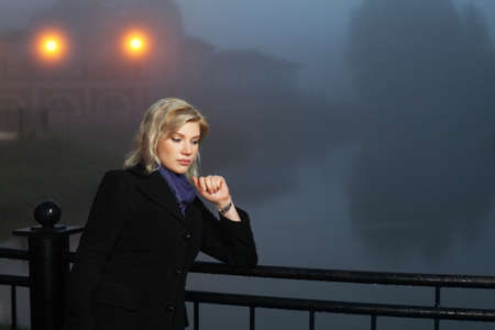 Young woman against a night foggy landscape Stock Photo - 16131672