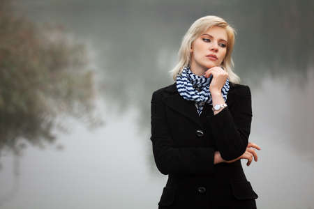 Young woman against a morning foggy landscape Stock Photo - 16131674