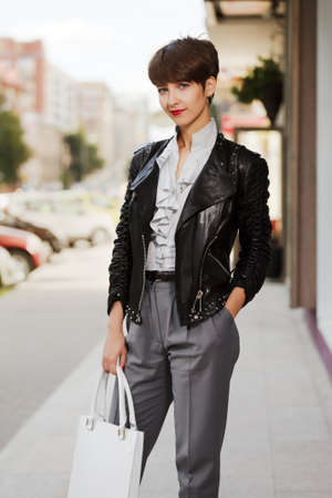 Young woman in leather jacket