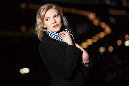 Young woman against a night city Stock Photo - 16249359