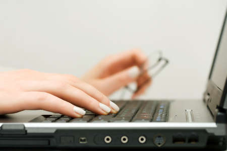 Female hands using laptop Stock Photo - 16452267