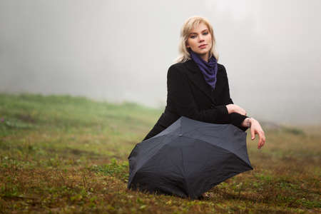 Young woman against a morning foggy landscape Stock Photo - 16391844