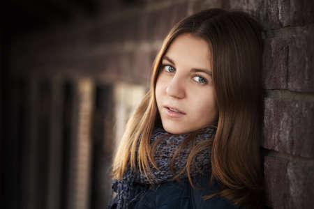 looks: Teenage girl against a brick wall