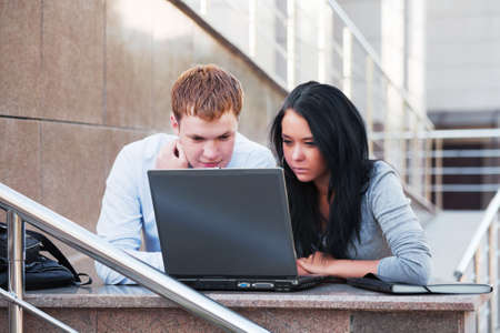 Young business people using laptop  Imagens