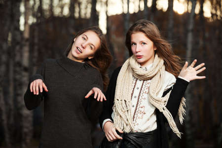 Young girls in an autumn park Stock Photo - 16431744