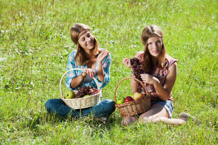 Teenage girls with a fruit baskets photo